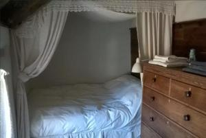 A bed or beds in a room at Cartws Bach