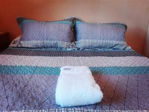 A bed or beds in a room at CONFORTABLE DEPARTAMENTO PARA 2 PERS.