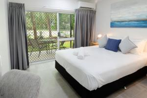 A bed or beds in a room at TiTree Resort Apartments