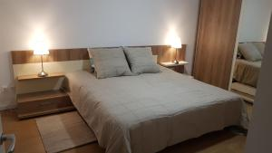 A bed or beds in a room at Top Trio Residence