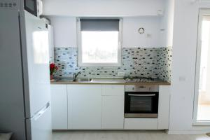 A kitchen or kitchenette at Airport Residence - Across from Otopeni Airport