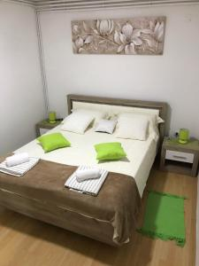 A bed or beds in a room at Airport Stay Apartment