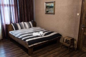 A bed or beds in a room at Luxusni Apartmany Stodolni