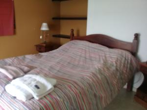 Una cama o camas en una habitación de Lago y sol
