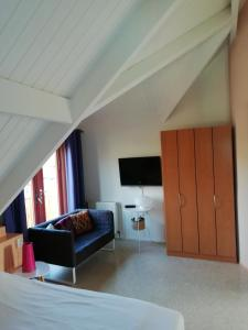Een TV en/of entertainmentcenter bij Frejus 134