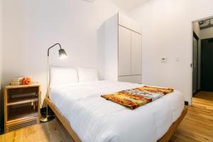 Ein Bett oder Betten in einem Zimmer der Unterkunft WeLive Wall Street