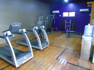 The fitness centre and/or fitness facilities at Flat Mercure 1401 Vista do Mar