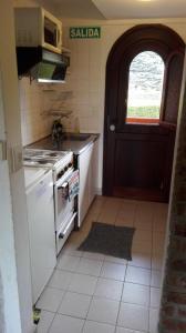 Una cocina o kitchenette en Saint Moritz 6