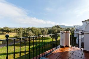 A balcony or terrace at Arcos Gardens Sol Rent Golf