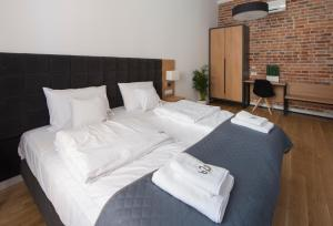 A bed or beds in a room at Aparthotel BC 29 Residence
