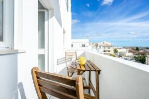 A balcony or terrace at My Place @ Faro Ria Views