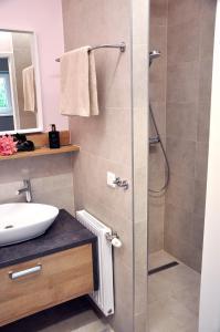 Ein Badezimmer in der Unterkunft MINT Apartment