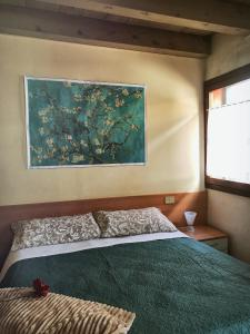 A bed or beds in a room at Venice Apartment