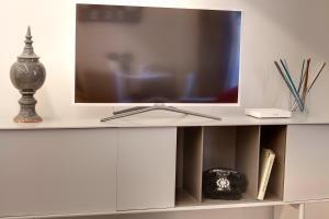 Een TV en/of entertainmentcenter bij Mattonaia Apartment