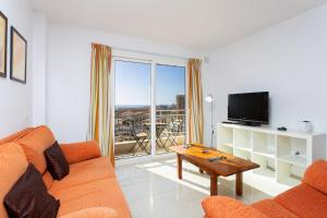 Zona de estar de HomeLike Las Vistas Beach Views