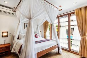 Un ou plusieurs lits dans un hébergement de l'établissement Desamuda Village