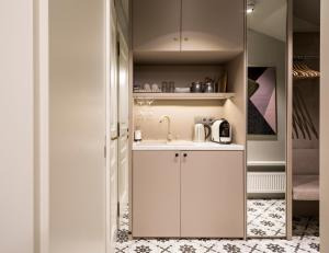 A kitchen or kitchenette at Moja apartments