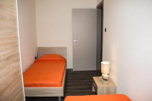 A bed or beds in a room at Aragon Apartment