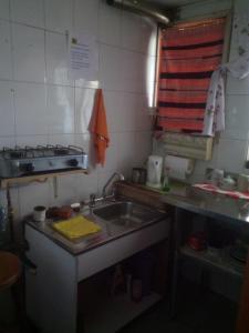 A kitchen or kitchenette at Habitación Independiente