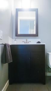 A bathroom at Spacious 3 Bdrm home near downtown