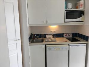 Kjøkken eller kjøkkenkrok på Vue mer dans Résidence l'estran