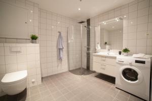 Vonios kambarys apgyvendinimo įstaigoje BJØRVIKA APARTMENTS, Damsgård Area, Bergen city center