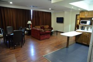 A seating area at The Palace Suites