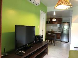 TV a/nebo společenská místnost v ubytování Porto Praia do Forte