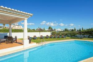 The swimming pool at or near Villa Damara