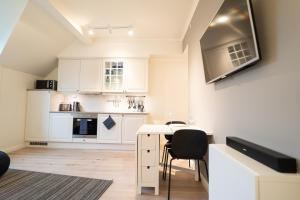 A kitchen or kitchenette at Heart of Tromsø
