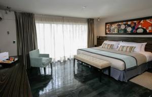 Cama ou camas em um quarto em Santiago Apartamentos Gen