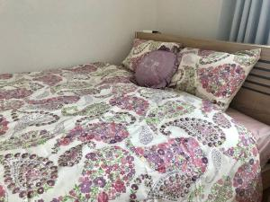 A bed or beds in a room at Jade tree house