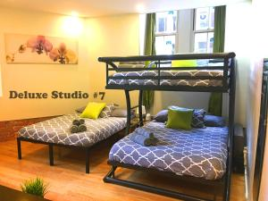 A bunk bed or bunk beds in a room at Green Holidays Apartments