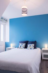 Ein Bett oder Betten in einem Zimmer der Unterkunft Résidence La Plage d'Or