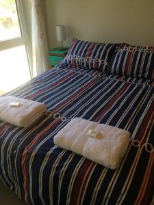 Una cama o camas en una habitación de Departamento céntrico UMAIN