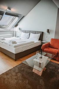 Ein Bett oder Betten in einem Zimmer der Unterkunft KH Apartments Center