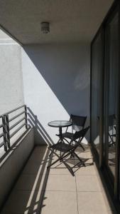 Un balcón o terraza de M-Montt Providencia Apartamentos Amoblados