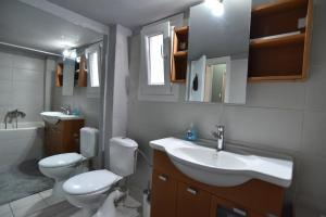 Ένα μπάνιο στο Center Travellers Apartment