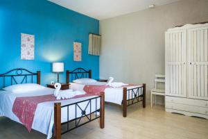 A bed or beds in a room at Irilena Studios and Apartments