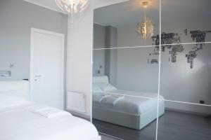 A bed or beds in a room at Cagliari View Apartment
