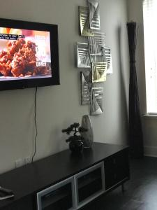 A television and/or entertainment center at Co-z Buckhead condo