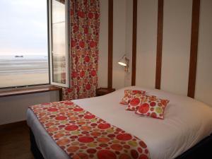 Un ou plusieurs lits dans un hébergement de l'établissement Gîtes en Normandie en Front de Mer Asnelles