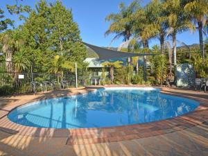 The swimming pool at or near Cabin 27 @ Kangaroo Valley Resort & Golf Club