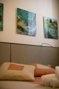A bed or beds in a room at Residenza L'isola - Il Chiostro by Dimorra