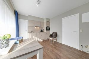 A kitchen or kitchenette at Holiday Suites De Haan