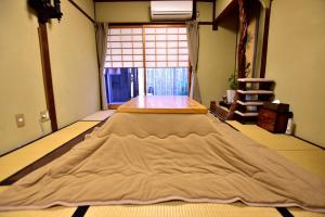 A bed or beds in a room at Kyo no Yado Bamboo Town