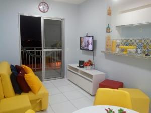 A seating area at Apartamento Pleno