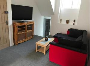A television and/or entertainment center at 33A Sunderland Road