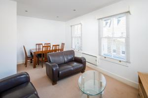 A seating area at OYO Home Waterloo Executive 1