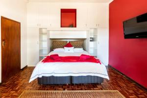 A bed or beds in a room at Saxenburg Wine Farm
